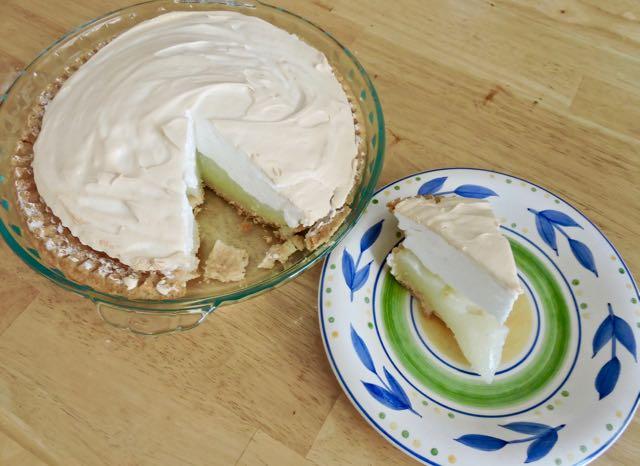 kitchen lemon meringue pie and piece - 1
